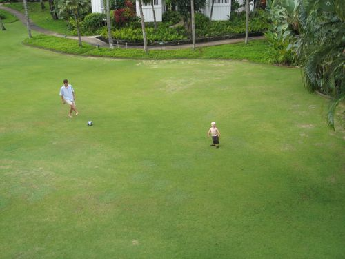 Playing soccer on the lawn outside condo